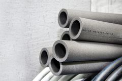 Tubular insulation made of polyethylene foam in the store royalty free stock photography