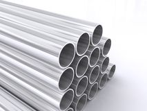 Tubular metal pipes. Pile of tubular silver colored metal pipes isolated on white background Royalty Free Stock Photo