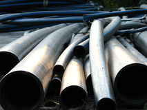 Tubular view. Aluminium pipes gathered together in a pile Stock Photos