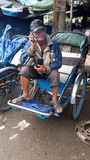 Tuc tuc driver hue market. Fruit lady market selling dragon fruit driver Stock Image