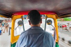 Tuc Tuc rickshaw taxi driver in New Delhi. Interior and taxi driver of so called Tuc Tuc rickshaw car in New Delhi, India Royalty Free Stock Images