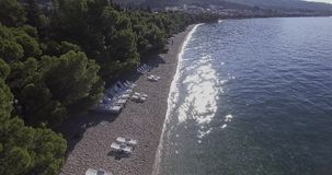 Tucepi aerial view. Aerial view of the town Tucepi beach on a sunny day, the Adriatic coast of Croatia stock video footage