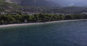 Tucepi beach aerial view. Aerial view of the town Tucepi beach on a sunny day, the Adriatic coast of Croatia stock footage