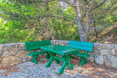 Tucepi green benches Stock Photo