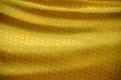 Tuch des Goldes. lizenzfreie stockfotografie