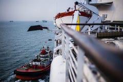 Tug boat towing ship Royalty Free Stock Photography