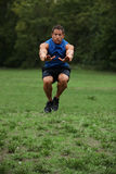 Tuck jump work out Stock Images