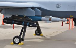 Hellfire Missile on a Drone. Tucson, AZ, USA - March 23, 2019: An AGM-114 Hellfire missile and a GBU-12 Laser Guided Bomb, mounted on an MQ-9 Reaper drone royalty free stock image