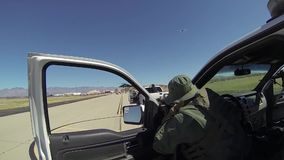 TUCSON, MARCH 2016, Boarder Patrol officers save area and throw flash bang. US Boarder Patrol officers save the area around a fleeing person. One of them throw stock video footage