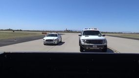 TUCSON, MARCH 2016, Fleeing car and police car are stopping. A fleeing car stops. The following police cars stop also stock footage
