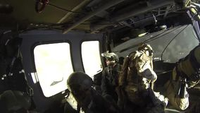 TUCSON, MARCH 2016, Police officers and soldiers sit in helicopter till flight. US police officers and soldiers of Homeland Security sit in a Boarder Patrol stock video