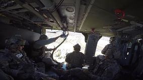 TUCSON, MARCH 2016, Police officers and soldiers sit in helicopter till flight. US police officers and soldiers of Homeland Security sit in a Boarder Patrol stock footage