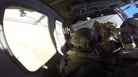 TUCSON, MARCH 2016, Police officers and soldiers sit in helicopter till flight. US police officers and soldiers of Homeland Security sit in a Boarder Patrol stock video footage