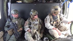 TUCSON, MARCH 2016, Police officers and soldiers sit in helicopter. US police officers and soldiers of Homeland Security sit in a Boarder Patrol helicopter stock video