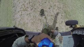 TUCSON, MARCH 2016, Soldiers rappeling out of helicopter. A soldier is rappeling out of a flying helicopter stock video footage
