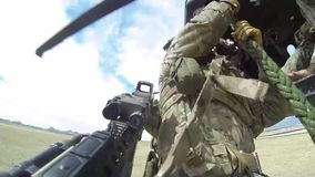 TUCSON, MARCH 2016, Soldiers rappeling out of helicopter. A soldier is rappeling out of a flying helicopter stock video