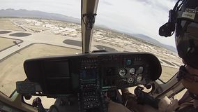 TUCSON, MARCH 2016, US police helicopter fly over airfield. A US policce helicopter fly over a airfield at day stock video