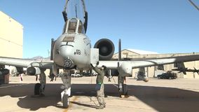 TUCSON USA, JANUARY 2016, US Air Force Close Door A-10 Thunderbolt Aircraft. A US soldier close the door of a A-10 aircraft at a airbase stock footage