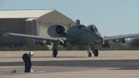 TUCSON USA, JANUARY 2016, US Air Force A A-10 Thunderbolt Aircraft Roll Along Airfield Soldier Delegate stock video footage