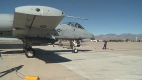 TUCSON USA, JANUARY 2016, US Air Force A A-10 Thunderbolt Aircraft Roll Park Position Soldier Give Commands stock footage