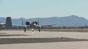 TUCSON USA, JANUARY 2016, US Air Force Two A-10 Thunderbolt Aircraft Roll Along Airfield stock video footage