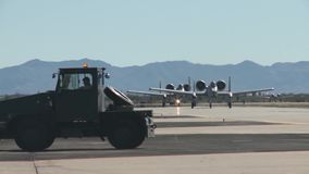 TUCSON USA, JANUARY 2016, US Air Force Two A-10 Thunderbolt Aircraft Roll Along Airfield Follow Me. Two A-10 Thunderbolt aircraft roll along a airfield. A Follow stock footage