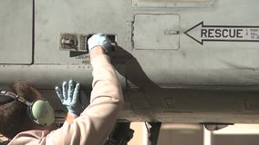 TUCSON USA, JANUARY 2016, US Soldier Connect Aircraft Radio. US Air Force. A ground member connects his radio at a A-10 Tunderbolt aircraft stock footage
