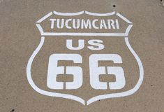 Route 66 sign on sidewalk in Tucumcari Stock Photography