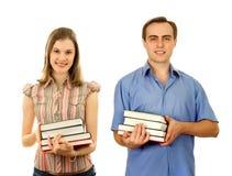 ?tudents con i libri. Isolato su bianco. Fotografie Stock