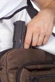 Étudiant avec l'arme à feu Photos stock