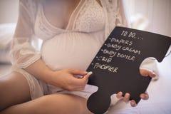Tudo que é necessário para que o bebê venha ao mundo imagem de stock