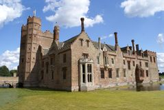 Tudor architecture with a bridge, towers, & a moat Stock Image