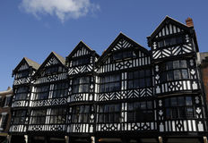Tudor Black and White Building. Old black and white tudor building in Chester England showing leaded windows Royalty Free Stock Photo