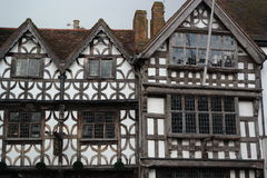 Tudor building Stratford on Avon. Detail of black and white timber framed tudor building in stratford on avon, England patterned frontage sunlit Stock Photography