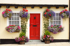 Tudor cottage, with hanging baskets. Stock Photo