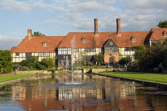 Tudor framed house at RHS Wisley. The Tudor frames house reflecting in the pond at RHS Wisley on an Autumn day Royalty Free Stock Image