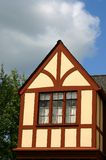 Tudor gable. Detail of Tudor gable with stucco and exposed beams stock photos