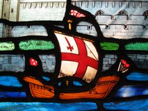 Tudor galleon on a stained glass window. Image of a Tudor galleon on a stained glass window at the early medieval church of All Hallows by the Tower, London Royalty Free Stock Photo