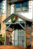 Tudor Home for the Holidays. Front door of Tudor home with Christmas wreath Stock Images