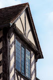 Tudor house exterior detail built in 1590 detail of window and roof Blakesley hall closeup.  Stock Photos