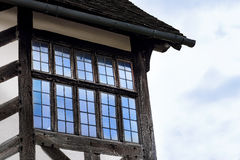 Tudor house exterior detail built in 1590 detail of window and roof Blakesley hall closeup.  Royalty Free Stock Photos