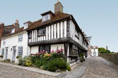 Tudor house with flower bed Stock Photos