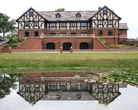 Tudor House Reflections. A Large Estate Home in the UK with Reflections in a Lake Royalty Free Stock Photos