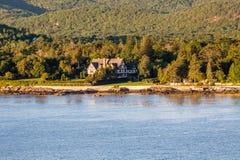 Tudor Mansion Among Coastal Evergreens images libres de droits