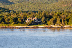 Tudor Mansion Among Coastal Evergreens Royalty Free Stock Images