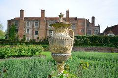 Tudor mansion with garden. Tudor mansion with vase in foreground Stock Image