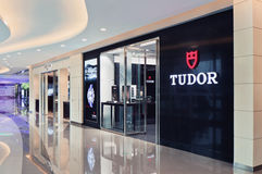 Tudor outlet in a shiny shopping mall, Shanghai, China. SHANGHAI-DEC. 8, 2015. Tudor outlet. Rolex and its 4subsidiary Tudor manufacture wristwatches. Founded by Royalty Free Stock Image