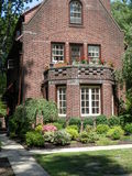 Tudor Style Brick Home  in Forest Hills, N.Y. Tudor Style Brick Home Front  in Forest Hills, N.Y.with pretty shrubs and terrace Stock Images