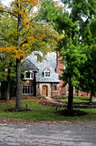 Tudor style home. Image of a tudor style home on a wooded lot stock photo