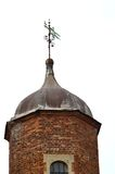 Tudor tower with lead roof. And weather vane Royalty Free Stock Photo
